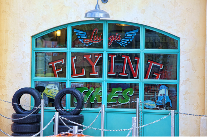 Luigis Flying Tires Handpainted Window Sign